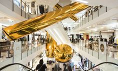 people's architecture office (PAO) has installed 'golden bubbles', a series of massive metallic objects within the art mall in hong kong. China Architecture, Architecture Panel, Commercial Architecture, Architecture Office, Classical Architecture, Architecture Design, Building Architecture, Shopping Mall Interior, Shopping Malls