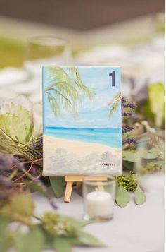 Petite Paintings - Have pretty scenes painted onto mini canvases and propped onto little easels for an artistic touch. {Thompson Photography Group}