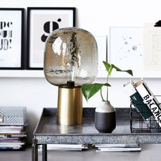 This smoked glass brass lamp is so glam and is the perfect way to create low mood lighting. Looks brilliant on or off and is super stylish. We're in love.  Available at housecurious.co.uk