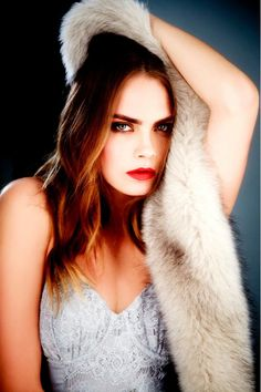 Cara Delevingne pairs a fur stole with a lace corset top for a BO.BÔ campaign.