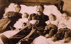 Memento mori - The entire family was shot in their home and dumped into a nearby river, where officials fished the bodies out and eventually took this picture.