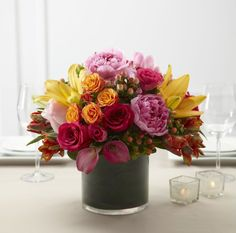 Color Mix Centerpiece - http://www.designsbysandrallc.com/custom_orders.php