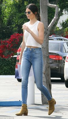 Off-duty look: Kendall Jenner opted for high-waisted jeans and a tank top during her casua...