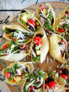 Salad Stuffed Shells. Need to try these for our grill out next week. Love the idea.