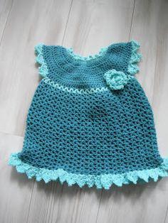 Voor een babymeisje, dit gehaakte jurkje van mama lieveheersbeestje.