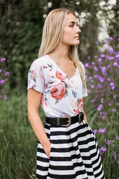 Peach floral v neck tee  Model is 5'9'' wearing size Medium