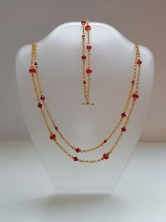Gold coloured chains with glass beads. Nice for Christmas