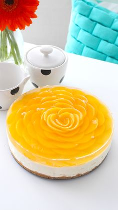 Peach slices are arranged on top of this no-bake cheesecake to look like a…