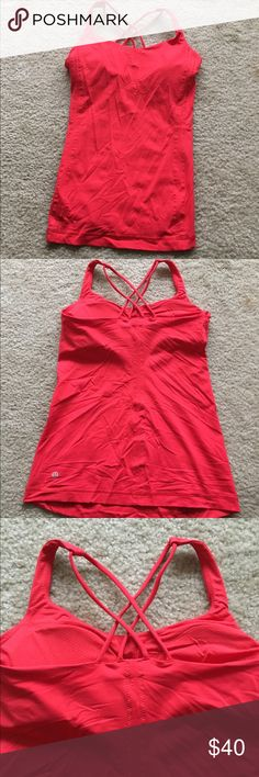 Lululemon Top Beautiful color, great criss-crossed back, built in bra, never worn! lululemon athletica Other