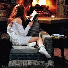 ❝Ginny was curled like a cat on her chair, but her eyes were open; Harry could see them reflecting the firelight.❞