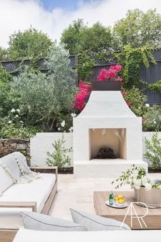 Stucco Outdoor Fireplace - Design photos, ideas and inspiration. Amazing gallery of interior design and decorating ideas of Stucco Outdoor Fireplace in living rooms, decks/patios, pools, kitchens by elite interior designers. Rustic Outdoor Fireplaces, Outdoor Fireplace Designs, Backyard Fireplace, Fireplace Ideas, Stucco Fireplace, Build Outdoor Fireplace, Fall Fireplace, Fireplace Seating, White Fireplace
