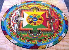 Tibetan Mandala. So much work, meditation, beauty and intent, just to be swept away upon completion.