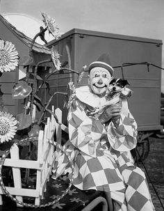 Ringling clown Charlie Bell with his dog in Sarasota, Florida. Photo by State Library and Archives of Florida, 1950.