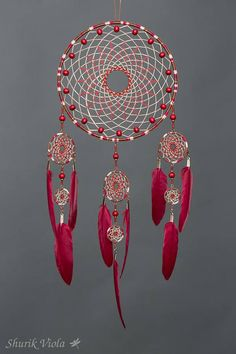 American indian spiritual accessory to protect dreams. According to the legend, dreamcatcher let the good dreams go through the hole in the middle and catches bad ones, keeping them untill the morning when they disappear with the light. It is also a nice decorative accesory for people who