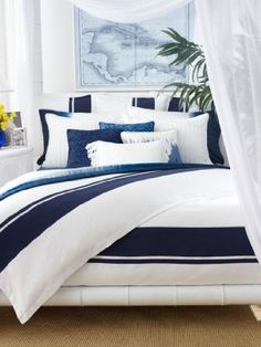 Ralph Lauren Indigo Modern, things I like: tie dye sheets, crisp white  navy, the plant near bed styling, sheer white canopy, world map on wall, nightstand with flowers.