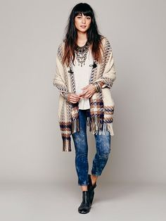 Poncho, denim skinnies, ankle boots, ethnic sterling and casual white tee. Boho winter layers at Free People.