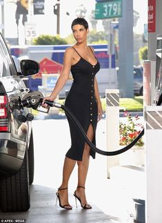 Wow: Nicole Murphy, 49, couldn't resist showing off her age-defying genetics as she pumped gas at the petrol station in Los Angeles on Tuesday