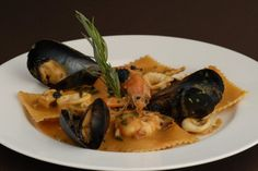 Caffe Milano's specialties include homemade pastas and fresh local seafood.