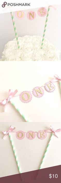 Adorable 1st Birthday Cake Topper Pink, Mint, and Gold First Birthday Cake Topper. Perfect for baby's first smash cake!! Brand New, never used. The paper straws are mint and white with a pink pennant with ONE in gold, and pretty pink bows on the straws. Other