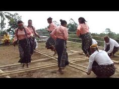 traditional stick dance at Melo Village