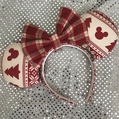 Beige and Red Vintage Ugly Sweater Minnie mouse ears with a plaid flannel bow. These are perfect for the Holiday season at the parks! The headband is hand wrapped and covered with fabric and lined on the inside. My ears are all made to be puffy at about 2 inches wide, these are not