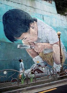 The communicative power of street art.   An artwork by the artist Kay 2 in Busan, Korea