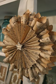 ~ Vintage Sheet Music Wreaths ~ WoW.  I think you could do the same thing with wrapping paper for special occasion wreaths