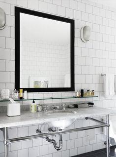 White Bathroom With Black Mirror & Subway Tile