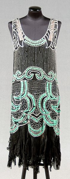 """1920s woman's beaded dress,    Sign In to see what this sold for  tunic-style black chiffon dress with clear seed and tubular beads, medium green square and circular disks (possibly celluloid), 44"""" shoulder to hem"""