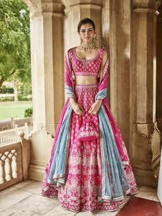 If you are bride/groom's sister, undoubtedly you have to look like a star. Definitely go for a beautiful lehenga that makes you look no less than a princess. The perfect way to do that? Adorn a pink lehenga choli with some elegant jewellery. Indian Bridal Outfits, Indian Designer Outfits, Indian Dresses, Lehenga Choli Designs, Indian Lehenga, Blue Lehenga, Pakistani, Pink Bridal Lehenga, Raw Silk Lehenga