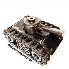 What better way to protect the items on your desk at work than with a miniature army tank! This tank is made from scrap metal and packs a big punch