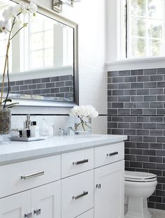 Grey Subway Tile Wainscoting - Grey subway tile wainscoting pops against white details