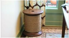 Take an old spool (you can get them at home depot), wrap it with rope or yarn, and use it as a side table. Would be perfect for the sewing room!