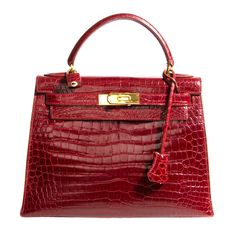 RARE STUNNING HERMES CROCODILE SHINY KELLY 28CM ' ROUGE HERMES'...not sure but I think this goes for one hundred thousand dollars...peeps wait years to get one