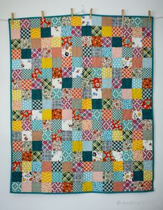 """@Audrie Bidwell from Blue is Bleu made an adorable patchwork quilt in beautiful Denyse Schmidt Quilts fabrics that would make any baby completely happy!   """"The squares were 3.5"""" finished and I used a natural 50wt #Aurifil thread to quilt in a grid pattern down the middle of the squares.""""  To see more please visit http://blueisbleu.blogspot.com/2013/08/ds-patchwork-baby-quilt.html"""