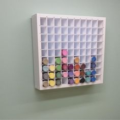 The craft storage organizer for acrylic paint bottles hanging on the wall.
