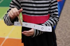 "Each child has a laminated strip of vowels and a clothespin.    I say a CVC word like ""cat.""     The children listen and then put their clothespin on the vowel they hear in the CVC word."