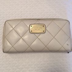 Michael kors white wallet Real Michael kors wallet ! Leather ! White ! Plenty of card space ! Wear and tear ! Lip gloss stain inside ! Michael Kors Accessories
