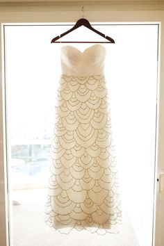 This dress is scalloped perfection: http://www.stylemepretty.com/2014/09/26/10-unique-wedding-dresses-to-swoon/   Photography: Melissa Green - http://www.melissagreenphotography.com/