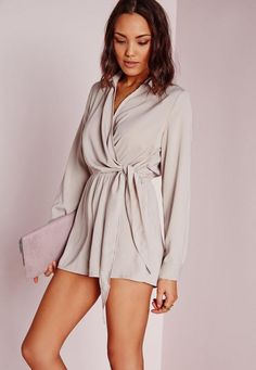 Step into the 60s with this style. It's all about the sleeves on this playsuit - roll up for a casual look, or up your game and team with block heels and a patent clutch to look head to toe woah. Featuring wrap over neckline and elasticated...