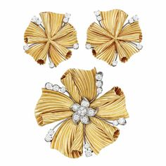Gold, Platinum and Diamond Clip-Brooch and Pair of Earclips, Cartier   14 kt., composed of cinched ribbed gold ribbons, spaced by knife-edge platinum tipped with 26 round diamonds, the clip-brooch centering a diamond-set platinum flower, totaling 32 round diamonds approximately 1.75 cts., signed Cartier, clip-brooch no. 12805, circa 1945, approximately 19 dwts.