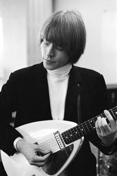 Original founding member of the Rolling Stones, Brian Jones playing his iconic Vox Teardrop guitar.