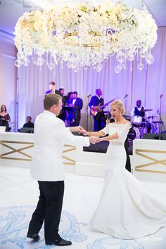 Beautiful couple dancing the night away in front of our Vail stage façade! www.perchdecor.com/product-category/stages | photo: John Cain Photography | event planning: Collins Coordination | halo: The Garden Gate | dance floor: DFW Dance Floors | #perchdecor