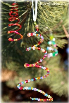 ths would be a great preschool craft ... motor skills .. Beaded homemade Christmas Tree ornaments for kids