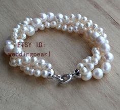 pearl jewelry: pearl bracelet lengh: 8 inches  bracelet material: natural freshwater pearl  bracelet characteristics:3 rows pearl bracelet pearl