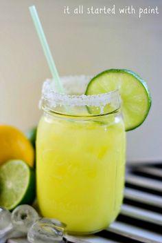 Low-cal Margarita recipe in a mason jar. Skinny Margarita at just 115 calories per glass. Easy recipe that can be stored in mason jars.