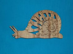Hey, I found this really awesome Etsy listing at https://www.etsy.com/listing/195271323/snail-wooden-scroll-saw-puzzle