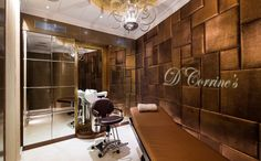 Golden brown padded wall. Eclectic chandeliers. We bet you will enjoy having a beauty care in this luxurious treatment room. Enjoy Ma'am!