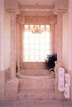 "PINK GLAMOUR - Cosmetic queen Mary Kay Ash took a page out of Liberace's decorating book to insprie her bathroom design in her Dallas mansion. The ""Mary Kay"" pink bathrooms were done by Venetian Marble of Lubbock."