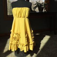 The SWEETEST summer dress The absolute most adorable dress for this summer! The beautiful golden yellow strapless sundress is perfect for any occasion! Lined and full of bounce!  Worn once, smoke free home, no flaws.  Grab a jean jacket or cardi and your ready for anything! Ryu Dresses Strapless